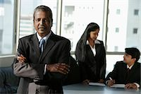 Mature Indian man standing in front of his colleages Stock Photo - Premium Royalty-Freenull, Code: 655-03458039