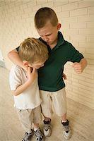 student fighting - Big Boy Bullying Little Boy in School Corridor Stock Photo - Premium Rights-Managednull, Code: 700-03458171