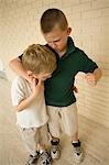 Big Boy Bullying Little Boy in School Corridor Stock Photo - Premium Rights-Managed, Artist: Raoul Minsart, Code: 700-03458171