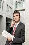 Businessman using mobile phone, waist up Stock Photo - Premium Rights-Managed, Artist: F1Online, Code: 853-03458815