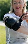 Senior woman tightening elbow pad, front view, close-up Stock Photo - Premium Rights-Managed, Artist: F1Online, Code: 853-03458835