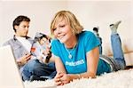 Teenager couple using media in living room, slanted view Stock Photo - Premium Rights-Managed, Artist: F1Online, Code: 853-03458847