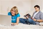 Teenager couple using media in living room, slanted view Stock Photo - Premium Rights-Managed, Artist: F1Online, Code: 853-03458850