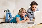 Teenager couple lying on carpet, watching media on notebook, low-angle view Stock Photo - Premium Rights-Managed, Artist: F1Online, Code: 853-03458861