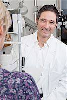 An ophthalmologist using a slit-lamp biomicroscope to examine a patient Stock Photo - Premium Royalty-Freenull, Code: 653-03459524
