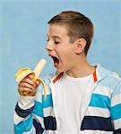 Boy Eating a Banana Stock Photo - Premium Royalty-Free, Artist: KL Services, Code: 600-03463154