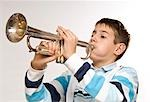 Boy Playing the Trumpet Stock Photo - Premium Royalty-Free, Artist: KL Services, Code: 600-03463165