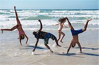Young group frolicking on beach Stock Photo - Premium Royalty-Freenull, Code: 649-03465844