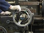 Hand Operating Wheel On Machine Stock Photo - Premium Royalty-Free, Artist: Bruce Fleming, Code: 649-03466090
