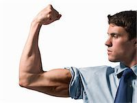 Businessman Flexing Bicep Stock Photo - Premium Rights-Managednull, Code: 700-03466492