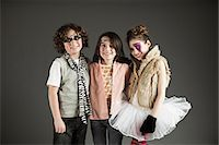 Three young friends dressed up Stock Photo - Premium Royalty-Freenull, Code: 614-03469522