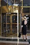 Woman Standing by Revolving Door Stock Photo - Premium Rights-Managed, Artist: Sarah Murray, Code: 700-03478751