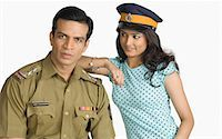 female police officer happy - Portrait of a policeman with a young woman standing beside him Stock Photo - Premium Royalty-Freenull, Code: 630-03479421