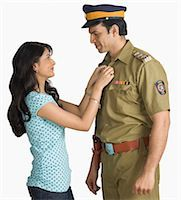 female police officer happy - Side profile of a policeman with his wife Stock Photo - Premium Royalty-Freenull, Code: 630-03479423