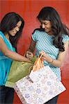 Teenage girl and a young woman holding shopping bags Stock Photo - Premium Royalty-Free, Artist: Michael A. Keller, Code: 630-03479451
