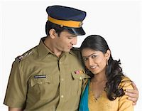 female police officer happy - Police officer standing with his arm around his wife Stock Photo - Premium Royalty-Freenull, Code: 630-03479464