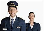 Portrait of a pilot with an air hostess
