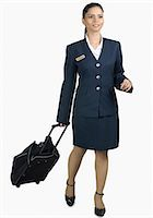 female white background full body - Air hostess carrying her luggage Stock Photo - Premium Royalty-Freenull, Code: 630-03479530