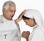 Nun confessing her sins to a priest
