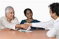 Couple discussing with a financial advisor Stock Photo - Premium Royalty-Freenull, Code: 630-03479738