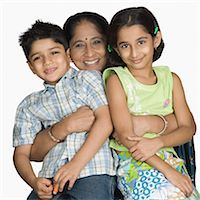 Mature woman carrying her grandchildren and smiling Stock Photo - Premium Royalty-Freenull, Code: 630-03479764