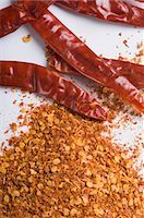 paprika - Close-up of red chili peppers with paprika Stock Photo - Premium Royalty-Freenull, Code: 630-03480040