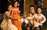 Family celebrating diwali Stock Photo - Premium Royalty-Freenull, Code: 630-03480213