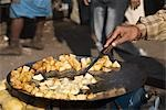 Man frying potato slices on a griddle, Delhi, India Stock Photo - Premium Royalty-Free, Artist: Ruslan_Kokarev, Code: 630-03480486