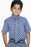Portrait of a schoolboy smiling Stock Photo - Premium Royalty-Freenull, Code: 630-03481235