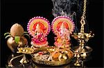 Diwali thali in front of idols of Lord Ganesha and Goddess Lakshmi Stock Photo - Premium Royalty-Free, Artist: Minden Pictures, Code: 630-03482073