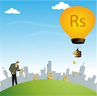 Businessman collecting sacks of rupees Stock Photo - Premium Royalty-Freenull, Code: 630-03482275