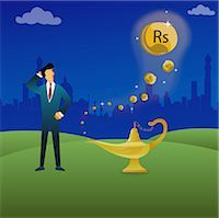 Businessman standing next to a magical lamp Stock Photo - Premium Royalty-Freenull, Code: 630-03482294