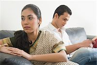 sad lovers break up - Woman looking sad with her husband reading a book Stock Photo - Premium Royalty-Freenull, Code: 630-03482662