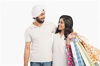 Couple standing together and smiling Stock Photo - Premium Royalty-Freenull, Code: 630-03482783