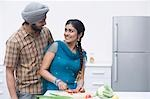 Couple chopping vegetables in the kitchen Stock Photo - Premium Royalty-Freenull, Code: 630-03482854