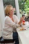 Woman Using Cell Phone Stock Photo - Premium Rights-Managed, Artist: Pierre Arsenault, Code: 700-03484631