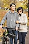 Couple Walking Outdoors in Autumn Stock Photo - Premium Rights-Managed, Artist: Jerzyworks, Code: 700-03484874