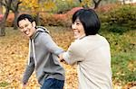 Couple Walking Outdoors in Autumn Stock Photo - Premium Rights-Managed, Artist: Jerzyworks, Code: 700-03484881