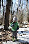 Boy Holding Stick in Forest in Winter Stock Photo - Premium Rights-Managed, Artist: Derek Shapton, Code: 700-03484894