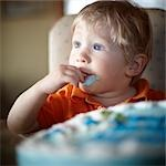 Toddler Eating Birthday Cake Stock Photo - Premium Rights-Managed, Artist: Derek Shapton, Code: 700-03484953