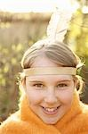 Close up of a girl wearing Indian feather headdress