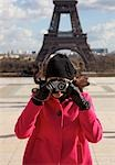 Woman taking a photo in front of the Eiffel Tower Stock Photo - Premium Rights-Managed, Artist: ableimages, Code: 822-03485239