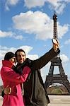 Couple taking a photo of themselves in front of the Eiffel Tower Stock Photo - Premium Rights-Managed, Artist: ableimages, Code: 822-03485252