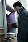 Man at ATM Stock Photo - Premium Rights-Managed, Artist: ableimages, Code: 822-03485423