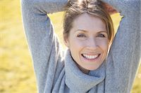 Close up of a woman with arms crossed over head Stock Photo - Premium Rights-Managednull, Code: 822-03485450