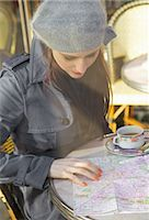 Young woman at cafe looking over a map Stock Photo - Premium Rights-Managednull, Code: 822-03485451
