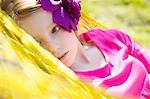 Close up of a girl with flower in her hair lying on a hammock Stock Photo - Premium Rights-Managed, Artist: ableimages, Code: 822-03485527