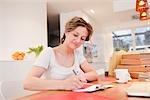 Woman writing address on an envelope Stock Photo - Premium Royalty-Free, Artist: Cultura RM, Code: 649-03487034