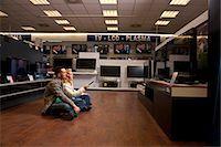 plasma - Young couple checking TV Stock Photo - Premium Royalty-Freenull, Code: 649-03487399