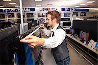 plasma - Measuring out a large-sized flatscreen Stock Photo - Premium Royalty-Freenull, Code: 649-03487416